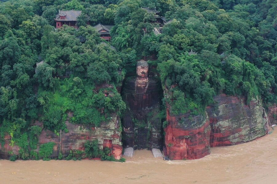 Flood in China washes feet of Buddha statue for the first time in 70 years